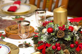 Elegant Christmas table decorated with typical and colorful obje — Stockfoto