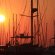 Masts of sailboats at sunset — Stock Photo
