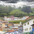 Fishing village of Cudillero in Spain with its surrounding fores — ストック写真