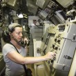 Stock Photo: Womdriving old submarine
