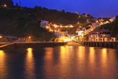 Night entrance from the sea to the fishing village of cudillero — Foto de Stock