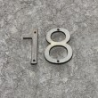 Number eighteen (18) on wall — Stock Photo #37694011