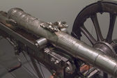 Small antique cannon, beautifully adorned — Stock Photo