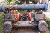 Mechanisms gears from old pipes and steam engines — Stock Photo