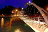 Modern iron bridge overnight in Cudillero, Spain — Stock Photo