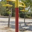 Stock Photo: Public park with exercise equipment