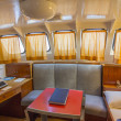 Spacious cabin of the captain of a small ship — Stock Photo #39632045