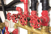 Pipes and valves of a ship — Stock Photo