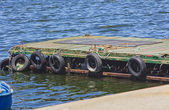 Small floating pier with tires — Stock Photo