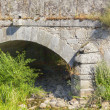 An ancient stone bridge arch — Stock Photo