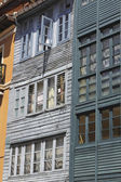 Old wooden building with many windows — Stock Photo