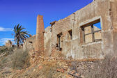Old village destroyed in ruins and abandoned by the bombs of war — Stock fotografie