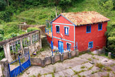 Bright coloured houses typical of this tourist village of fisher — Stock Photo