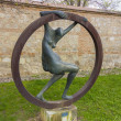 Abstract sculpture nude woman inside an iron ring — Stock Photo #51005585