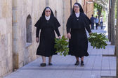 MADRID,SPAIN - APRIL 4:Nuns walking down the street prepared the — Stock Photo