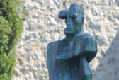 Modern abstract bronze sculpture of a person — Stock Photo