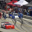 Stock Photo: Corvette passes Ford Can-Am in pit stop at Grand AM Rolex Races on MazdLagunSecRaceway