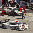 Постер, плакат: Ford Can Am passes Porsche GT2 in pit stop at Grand AM Rolex Races on Mazda Laguna Seca Raceway