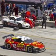 Stock Photo: MazdRX-8 GT passing Porche GT2 on pit stop