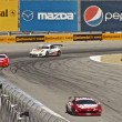 Stock Photo: High speed corner turn at Grand AM Rolex Races on MazdLagunSecRaceway