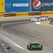 Постер, плакат: High speed corner turn at Grand AM Rolex Races on Mazda Laguna Seca Raceway