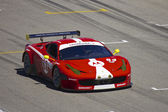 Ferrari F458 on track at Grand AM Rolex Races on Mazda Laguna Seca Raceway — Stock Photo