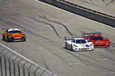 Mazda RX8 and Corvette Can-Am's at Grand AM Rolex Races on Mazda Laguna Seca Raceway — Stock Photo