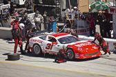 Corvette in pit stop at Grand AM Rolex Races on Mazda Laguna Seca Raceway — Stock Photo