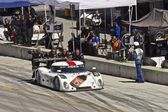 Ford Can-Am leaving pit stop at Grand AM Rolex Races on Mazda Laguna Seca Raceway — Stock Photo