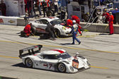 Ford Can-Am passes Porsche GT2 in pit stop at Grand AM Rolex Races on Mazda Laguna Seca Raceway — Stock Photo