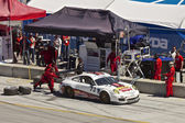 Porsche GT2 iin pit stop at Grand AM Rolex Races on Mazda Laguna Seca Raceway — Stock Photo