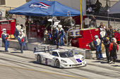 Corvette CanAm leaving pit stop at Grand AM Rolex Races on Mazda Laguna Seca Raceway — Stock Photo