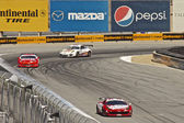 High speed corner turn at Grand AM Rolex Races on Mazda Laguna Seca Raceway — Stock Photo
