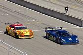 Mazda RX8 and Corvette CanAm at Grand AM Rolex Races on Mazda Laguna Seca Raceway — Stock Photo
