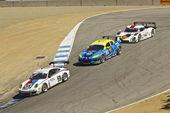Close chase at Grand AM Rolex Races on Mazda Laguna Seca Raceway — Stock Photo