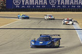 High speed corner turn at Grand AM Rolex Races on Mazda Laguna Seca Raceway — ストック写真