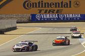 High speed corner turn at Grand AM Rolex Races on Mazda Laguna Seca Raceway — Stock Photo