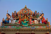 Hindu gods on a temple roof — Stock Photo