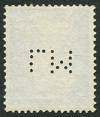 The reverse side of a postage stamp. — Stock Photo