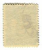 Yan ters bir posta pulu. — Stok fotoğraf