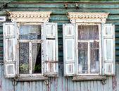 Wooden window with shutter doors. — Stock Photo