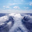 Blue ocean sea with fast yacht boat wake foam of prop wash — Stock Video