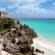 Stock Video: Ancient Tulum Mayan ruins over turquoise Caribbean sea mexico