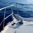 Boat sailing in a calm blue sea mediterranean water from bow — Stock Video