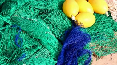 Fisherboat nets in blue and green color with yellow buoys — Stock Video