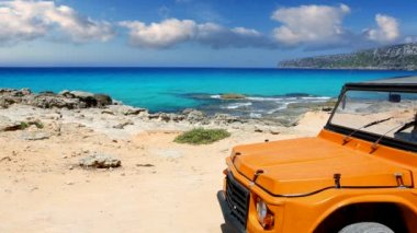 Beautiful beach with convertible car in ibiza with turquoise water — Stock Video