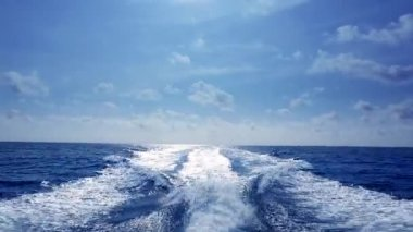 Blue ocean sea with fast yacht boat wake foam of prop wash — Stock Video #12679035