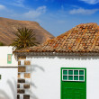 Royalty-Free Stock Photo: Lanzarote Yaiza white village houses green window