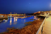 Lanzarote Puerto del Carmen harbour night view — Stock Photo