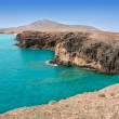 Lanzarote Papagayo turquoise beach and Ajaches — Stock Photo